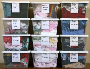 Clothes organized in clear storage bins